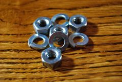 Nuts and washers. On wood background Royalty Free Stock Photos