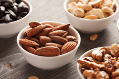 Nuts in white bowls close-up Royalty Free Stock Photos