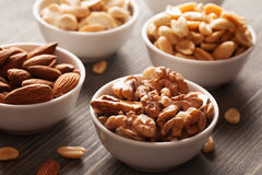 Nuts in a white ceramic bowls Stock Images