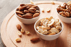 Nuts in a white ceramic bowls Royalty Free Stock Photos