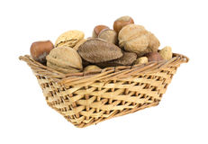 Nuts in wicker basket Royalty Free Stock Images