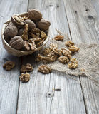 Nuts on wood background. Peanuts in a small basket on wood background Stock Image