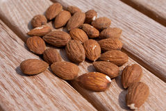 Nuts on wood table Royalty Free Stock Photo