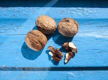 Nuts on wooden background Royalty Free Stock Photography