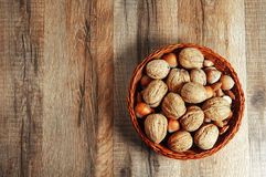 Nuts on a wooden background Royalty Free Stock Images
