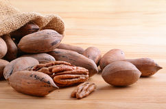 Nuts on wooden background Royalty Free Stock Photos