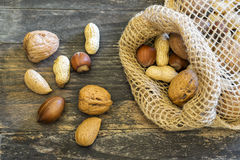 Nuts on a wooden board Royalty Free Stock Photography