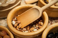 Nuts in a wooden Bowl Stock Photos