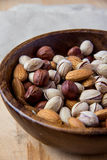 Nuts in wooden bowl. On wooden table Stock Image
