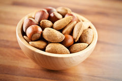 Nuts in wooden bowl Stock Photography