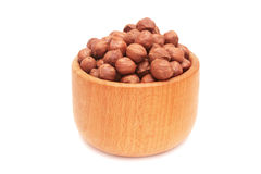 Nuts in wooden bowl. Stock Photos