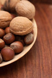 Nuts in a wooden bowl Stock Photo