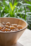 Nuts in wooden bowl Royalty Free Stock Photography
