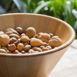 Nuts in wooden bowl Stock Image