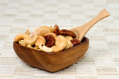 Nuts in a wooden bowl Royalty Free Stock Photography