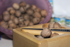 Nuts in a wooden box with nutcracker Royalty Free Stock Photo