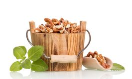Nuts in wooden bucket Royalty Free Stock Photo