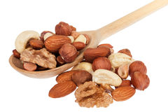 Nuts in a wooden spoon Stock Photos