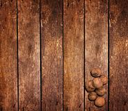 Nuts on the wooden table Stock Photography