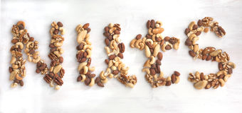 Nuts word from different nuts. Royalty Free Stock Photo
