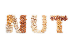 Nuts word from mixed nuts Stock Photo