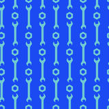Nuts and wrench jointless pattern. The group of a nuts and wrenches on the blue field Stock Images