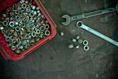 Nuts and wrenches Stock Images