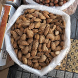 Nutshell almonds in round basket Royalty Free Stock Image