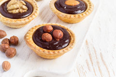 Nutty chocolate dessert small tarts closeup Stock Photography