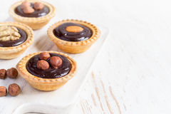 Nutty chocolate dessert small tarts  on a white background, spac Stock Photo