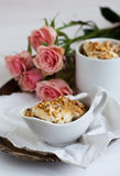 Nutty dessert and roses. On a tray Royalty Free Stock Photo