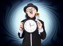 Nutty professor with clock. Crazy science time Royalty Free Stock Image