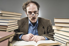 Nutty Professor in between a stack of books royalty free stock photo