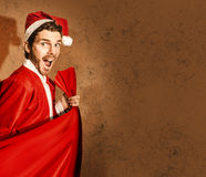Nutty santa in a mad rush shopping spree Royalty Free Stock Photos