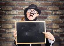 Mad scientist showing blank science diagram Stock Image