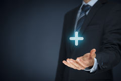 Nutzen plus Positiv lizenzfreie stockfotos