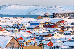 Nuuk city covered in snow with sea and mountains. In the background, Greenland Stock Image