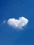 Nuvem dada forma coração Imagens de Stock