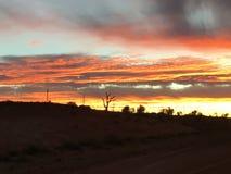Nuvens ajustadas do sol pedy de Coober Fotografia de Stock
