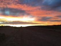 Nuvens ajustadas do sol pedy de Coober Imagem de Stock