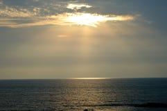 Nuvens bonitas da luz do sol Imagens de Stock