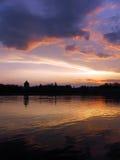 Nuvens da cor no lago Foto de Stock