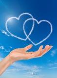 Nuvens dadas forma coração Fotos de Stock Royalty Free