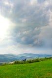 Nuvens de tempestade nas montanhas Imagem de Stock
