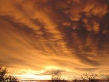 Nuvens douradas de Mammatus Foto de Stock Royalty Free