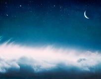 Nuvens e lua de incandescência Fotos de Stock Royalty Free