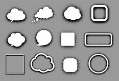 Nuvens e quadros brancos do discurso no cinza Imagens de Stock Royalty Free