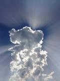 Nuvens e raios do sol Fotografia de Stock