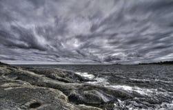 Nuvens e rochas. Fotos de Stock