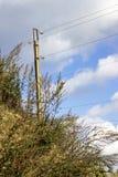 Nuvens sobre a linha elétrica Imagens de Stock Royalty Free